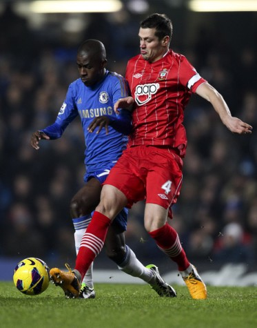 Schneiderlin wearing the captain's armband as he beats Ramires.