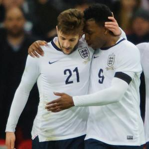 Lallana celebrates with scorer Sturridge after his assist.
