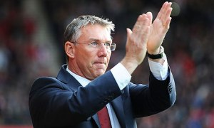 Nigel Adkins applauds the Saints fans for the last time at Old Trafford.