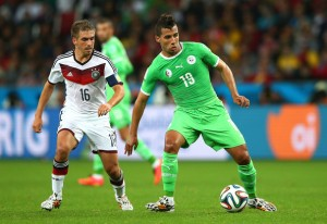 Saphir takes on Lahm at the World Cup.
